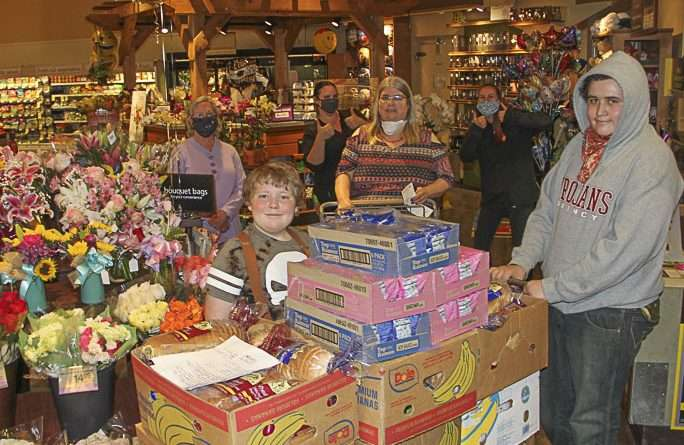 Two brothers triple new food drive success thanks to 9,000 donated Safeway Monopoly tickets